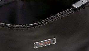 Tumi organizador de maleta neceser negro diseño interior